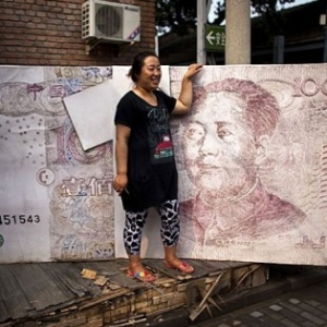 China's New Loans Fall 14% Raising Questions About Its Recovery