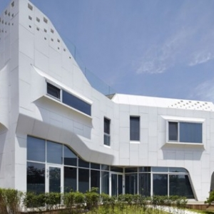 Curvy Eccentric White Residence With Square Perforations