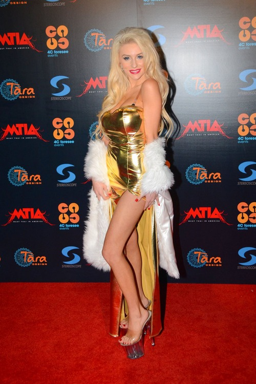 Courtney Stodden and Doug Hutchison (I spared you the kissy photo) walk the red carpet for the Muay Thai Championship Fights, to help celebrate the King of Thailand's 85th birthday, in Playa Vista.  Photo Credit: PacificCoastNews.com