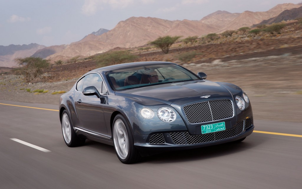 """The Continental GT was introduced in 2003 and, due to its extreme success, marked the first major step in Bentley's resurgence after its split with Rolls-Royce. For the 2011 Continental GT, Bentley hopes to build on its success by revising instead of remolding its form.  A more sculpted body gives the GT coupe a sharper and less bulbous appearance. The GT coupe's grille is more upright and new headlamps offer jewel-like detailing with LED lights. At the rear, Bentley's """"floating"""" LED lamps now extend around the corners. Aluminium Super Forming technology uses a single sheet of aluminum for some parts of the car's exterior. This process heats the aluminum panel to nearly 932 degrees Fahrenheit before shaping it with air pressure. Partly due to this process, the power lines and rear haunches are now sharper. A new trunk design also now features a powerful """"double horse-shoe,"""" much like the Mulsanne. The new GT is also more aerodynamic with a coefficient of drag that has been reduced to 0.33 Cd and the lift at the axles has been reduced to create greater stability at higher speeds.  Overall, the GT coupe is 143 pounds lighter thanks to reductions in many areas. The result is a marked improvement in the GT's power-to-weight ratio."""