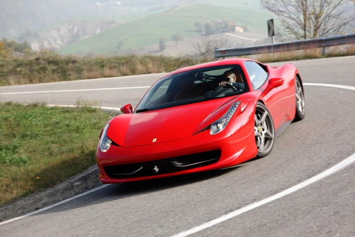 """Ferrari points to the number of awards its 458 Italia has won as a testament to the stellar nature of its track-ready sports car. Entering its third year on the market in 2012, the 458 Italia has already received more than 30 awards from around the globe. Motor Trend picked the 458 Italia from 10 other entrants as its Best Driver's Car for 2011, specifically commending the 458 Italia for the """"fine quality of its actions"""" and the """"satisfaction it gives to its pilot."""" Auto Express tested 30 performance cars and was able to extract its best track time ever in the 458 Italia, even besting the new McLaren MP4-12C to take home its award for Performance Car of the Year for the second year in a row.  These recent awards sit on the mantle next to other accolades for the 458 Italia since its launch in 2009 as a 2010 model. It has been CAR's Performance Car of the Year, the Daily Telegraph's Car of the Year, Fifth Gear's Fast Car of the Year, and Top Gear's Supercar of the Year and Car of the Year. Even parts of the 458 Italia have been recognized: in 2011, the International Engine of the Year Awards declared the naturally aspirated 4.5-liter V-8 in Ferrari 458 Italia the Best Performance Engine.  Since its inception as a successor to the beloved F430, the Italia has had one recall and a minor software upgrade. The sublime F430 is a tough act to follow, but Ferrari was so confident of its successor right from the beginning that it patriotically attached the name of the mother country, Italia, to the nameplate. Of course, the fact that a German, Michael Schumacher, played a key role in its development and, ultimately, how it drives, only enhances its credibility since he is also a seven-time world driving champion and a primary reason for the Italian automaker's recent Formula One success"""