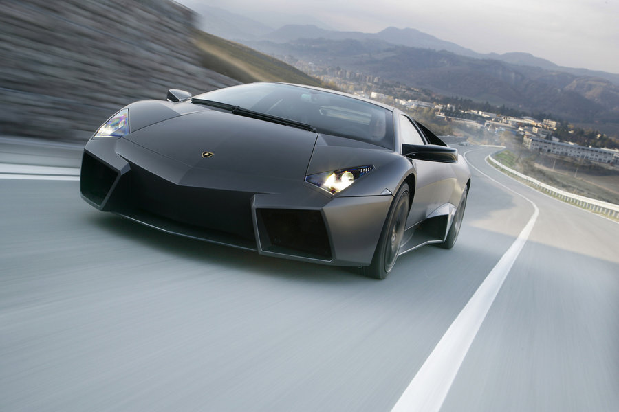 Background: Lamborghini newest supercar, the Reventon, was finally unveiled to a waiting public at the Frankfurt Auto show. So for approximately $1.5-million dollars you would expect to get the newest Enzo-beater and Veyron fighter, right? Not so with the newest Lambo. The extra $700,000 over the cost of a Murcielago LP640 will net 10 extra horsepower! That's an extra $70,000 per horsepower.  Exterior: Like most car companies nowadays, Lamborghini is pushing that its inspiration for this car was a supersonic jet, in this case an F-22 Raptor. The Reventon has looks that quite simply take your breath away; the styling of this car screams a cross between a transformer and an F-117 Stealth Fighter. It still looks very similar to the last Murcielago, just with sharper edges, larger scoops, rims that look like they could dice fruit, and two large tail lamps that are large enough to be hidden jet thrusters.  Performance: Since the Reventon engine, transmission, suspension, drive train, etc. are simply based off the Murcielago LP640, expect them to perform very similar to one another. The zero-to-60 time should be close to 3.4 seconds.