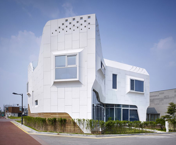 Curvy Details Curvy Eccentric White Residence With Square Perforations