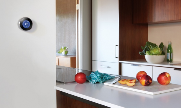 The Nest Smart Thermostat in Kitchen 5 Smart Home Technologies That Will Save You Money